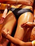 Woman having Ayurvedic spa treatment. Stock Images