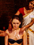 Woman having Ayurvedic spa treatment Stock Image