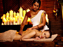 Woman having Ayurvedic spa treatment. Stock Images