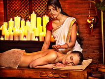 Woman having Ayurvedic spa treatment. Stock Image