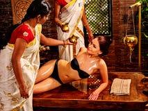 Woman having Ayurvedic spa treatment Stock Images