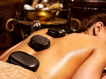 Woman having Ayurvedic stone massage. Stock Photography