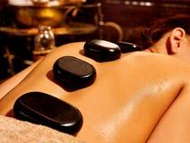 Woman having Ayurvedic stone massage Stock Photography