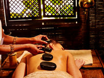 Woman having Ayurvedic stone massage Stock Images