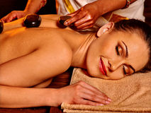 Woman having Ayurvedic stone massage Royalty Free Stock Photos