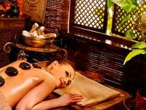 Woman having Ayurvedic stone massage Stock Photo