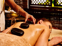 Woman having Ayurvedic stone massage Stock Images