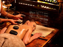 Woman having Ayurvedic stone massage. Royalty Free Stock Image