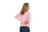 Woman having a back ache and holding her back Royalty Free Stock Photos