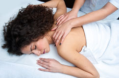 Woman having back adjustment Royalty Free Stock Images
