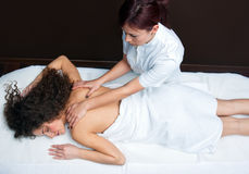 Woman having back adjustment Royalty Free Stock Photography