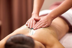 Woman having back massage with gel at spa Royalty Free Stock Photography