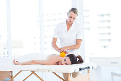Woman having back massage with massage ball Royalty Free Stock Photos