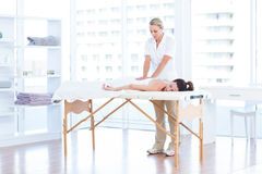 Woman having back massage Stock Images