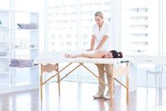 Woman having back massage Stock Images