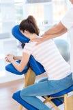 Woman having back massage Stock Photos