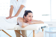 Woman having back massage Stock Image