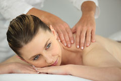 Woman having a back massage Stock Photography