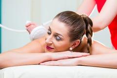 Woman having back massage in wellness spa Stock Image