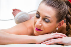 Woman having back massage in wellness spa Royalty Free Stock Images