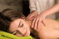 Woman having back massage Royalty Free Stock Image