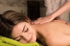 Woman having back massage Stock Photography
