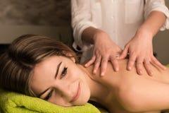 Woman having back massage Stock Image