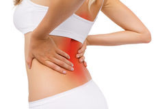 Woman having back pain. In white underwear Royalty Free Stock Photo