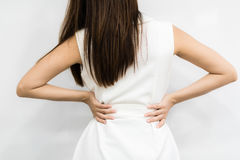 Woman having back pain from work. Stock Image