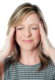 Woman having a bad headache Stock Photo
