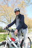 Woman having bike ride Stock Images