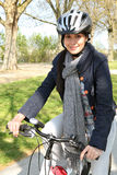 Woman having a bike ride Stock Photos
