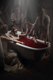 Woman having a blood bath Royalty Free Stock Photography