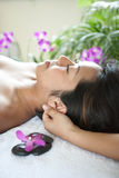 Woman having body massage from therapist Royalty Free Stock Photography