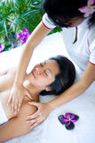 Woman having body massage from therapist Stock Photo