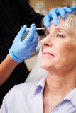 Woman Having Botox Treatment At Beauty Clinic. Close Up Of Woman Having Botox Treatment At Beauty Clinic stock images