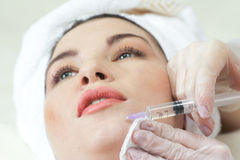 Woman Having Botox Treatment At Beauty Clinic Royalty Free Stock Images