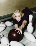 Woman having bowling accident Royalty Free Stock Images