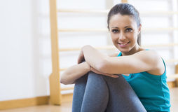 Woman having a break at gym Royalty Free Stock Images