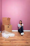 Woman having a break from packing for her home mov stock photo
