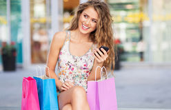 Woman having a break from shopping Stock Images