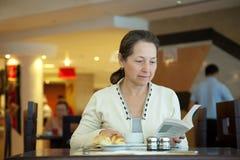 Woman having breakfast. In hotel restaurant Royalty Free Stock Photography