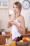 Woman having breakfast Stock Image