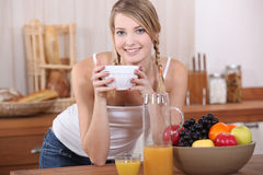 Woman having breakfast. Royalty Free Stock Photography