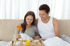 Woman having breakfast on the bed Royalty Free Stock Photo