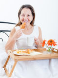 Woman having breakfast in bed Royalty Free Stock Photography