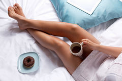 Woman having breakfast in the bed Royalty Free Stock Photography