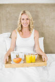 Woman having breakfast in bed Royalty Free Stock Photo