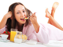 Woman having breakfast in bed Royalty Free Stock Images