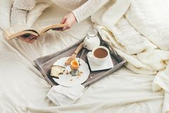 Woman having breakfast in bed. Stock Photography